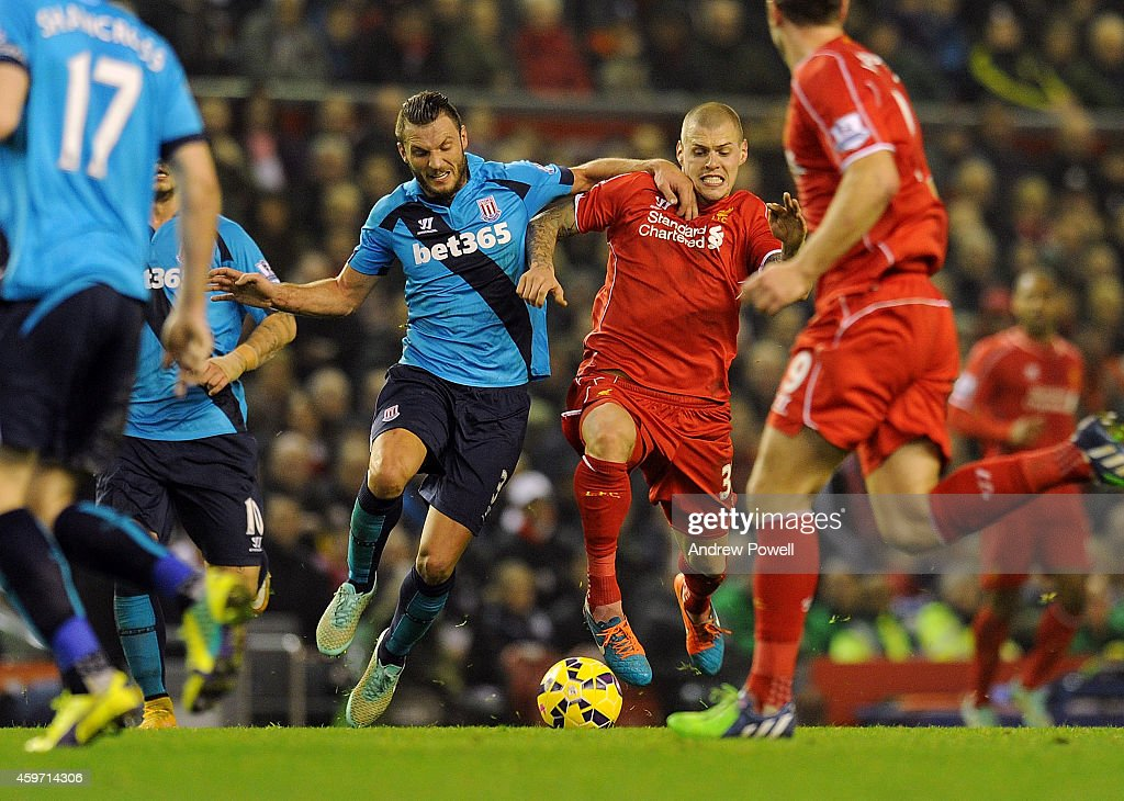Martin Skrtel of Liverpool and Erik Pieters of Stoke City compete during the Barclays Premier Leauge match between Liverpool and Stoke City at Anfield on November 29, 2014 in Liverpool, England.