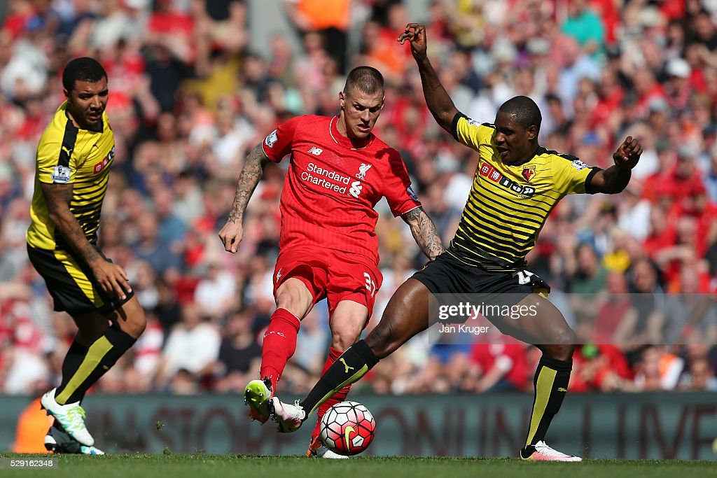 Martin Skrtel of Liverpool battles for the ball with Odion Ighalo of Watford during the Barclays Premier League match between Liverpool and Watford at Anfield on May 8, 2016 in Liverpool, England.
