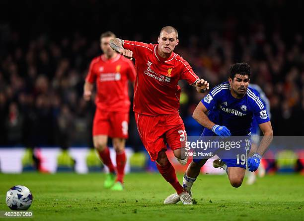 Martin Skrtel of Liverpool brings down Diego Costa of Chelsea during the Capital One Cup Semi-Final second leg between Chelsea and Liverpool at...