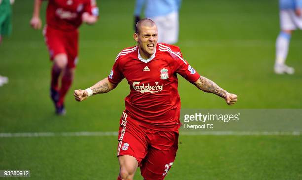 Martin Skrtel of Liverpool celebrates after scoring a goal against Manchester City during the Barclays Premier League match between Liverpool FC and...