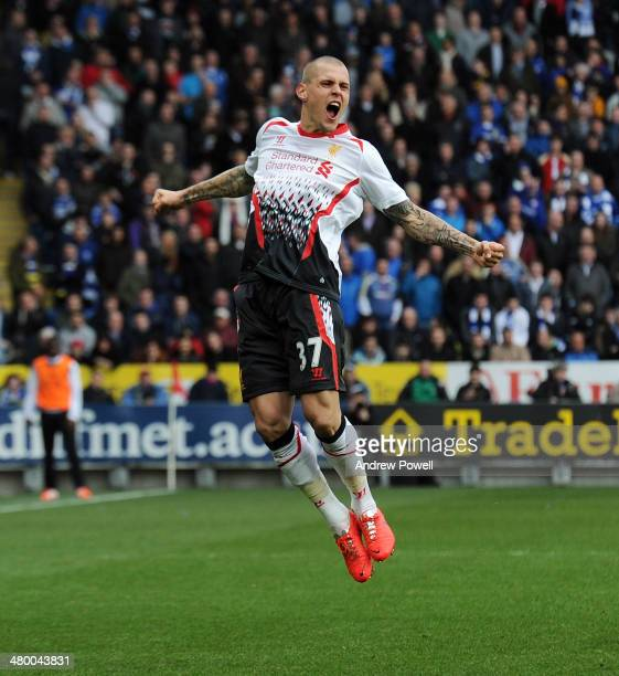 Martin Skrtel of Liverpool celebrates after scoring his second of the game during the Barclays Premier League match between Cardiff City and...