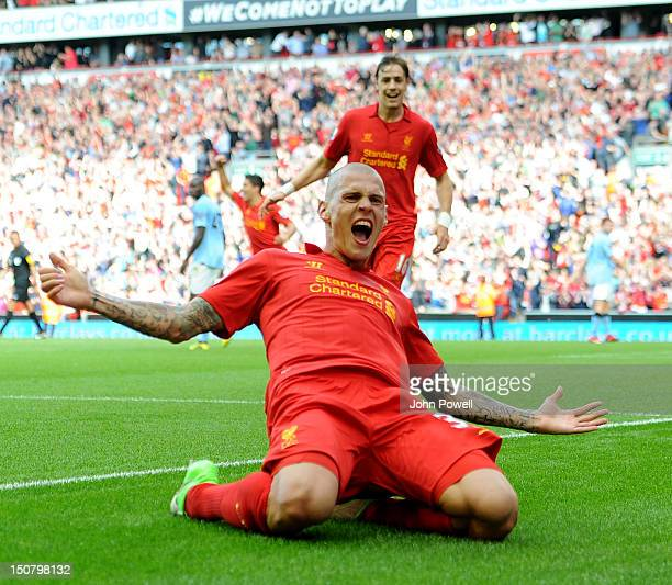 Martin Skrtel of Liverpool celebrates after scoring the first goal during the Barclays Premier League match between Liverpool and Manchester City at...