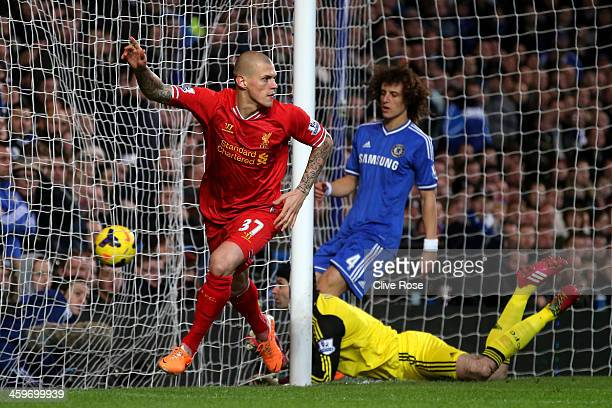 Martin Skrtel of Liverpool celebrates after scoring the opening goal during the Barclays Premier League match between Chelsea and Liverpool at...