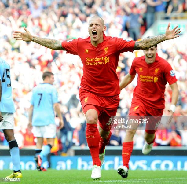 Martin Skrtel of Liverpool celebrates his goal during the Barclays Premier League match between Liverpool and Manchester City at Anfield on August 26...