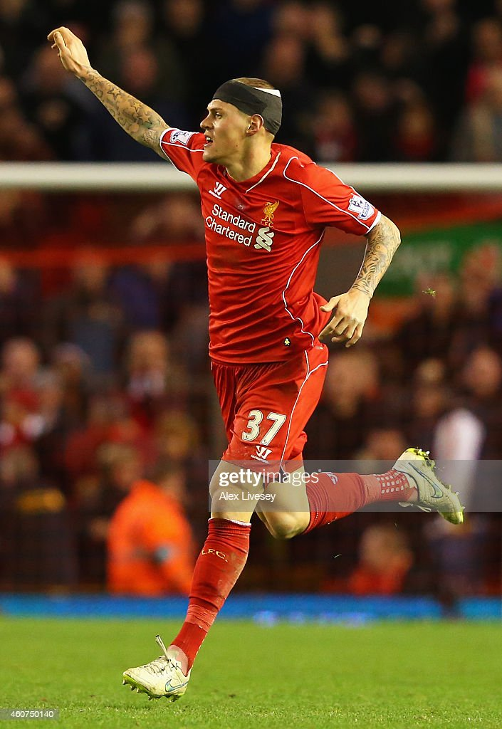 Martin Skrtel of Liverpool celebrates scoring his goal during the Barclays Premier League match between Liverpool and Arsenal at Anfield on December 21, 2014 in Liverpool, England.