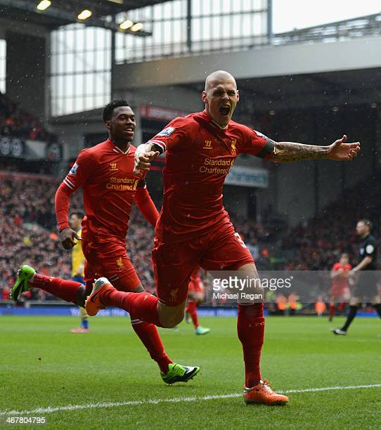 Martin Skrtel of Liverpool celebrates scoring the opening goal during the Barclays Premier League match between Liverpool and Arsenal at Anfield on...