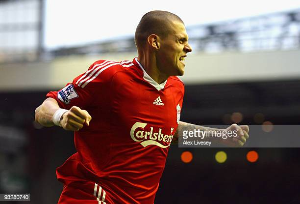 Martin Skrtel of Liverpool celebrates scoring the opening goal during the Barclays Premier League match between Liverpool and Manchester City at...