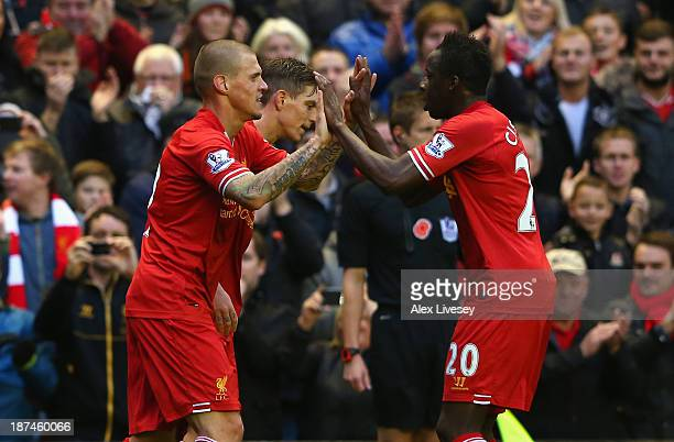 Martin Skrtel of Liverpool celebrates scoring the second goal with his teammate Aly Cissokho during the Barclays Premier League match between...