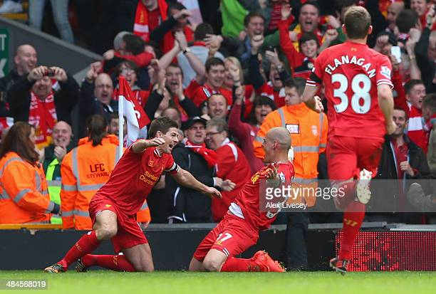 Martin Skrtel of Liverpool celebrates scoring the second goal with team-mate Steven Gerrard during the Barclays Premier League match between...