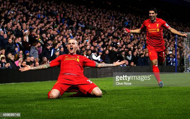 Martin Skrtel of Liverpool celebrates with teammate Luis Suarez after scoring the opening goal during the Barclays Premier League match between...