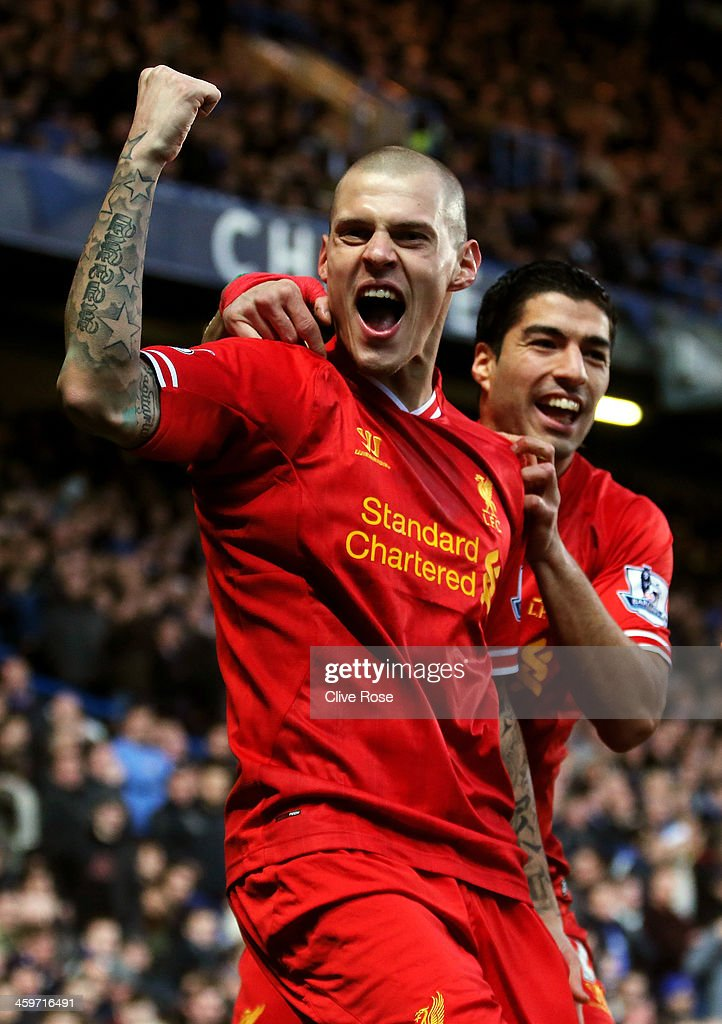 Martin Skrtel of Liverpool celebrates with teammate Luis Suarez (R)after scoring the opening goal during the Barclays Premier League match between Chelsea and Liverpool at Stamford Bridge on December 29, 2013 in London, England.