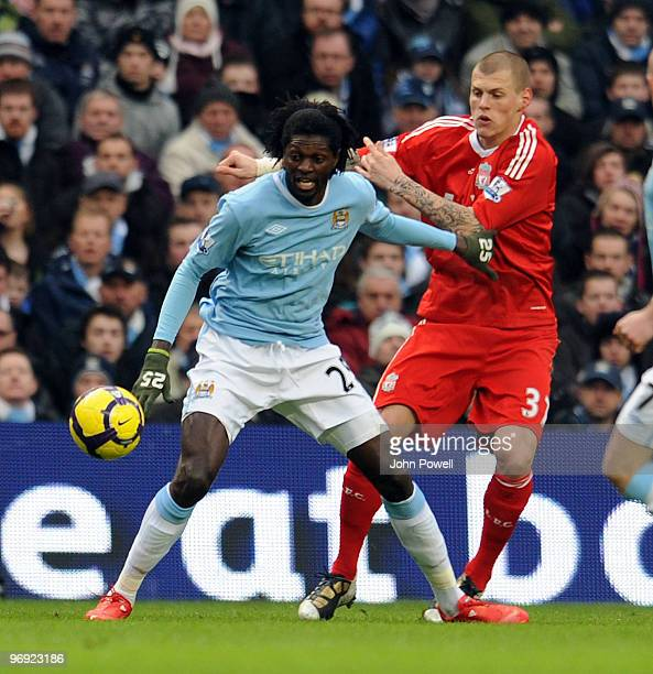Martin Skrtel of Liverpool competes with Emmanuel Adebayor of Manchester City during the Barclays Premier League match between Manchester City and...