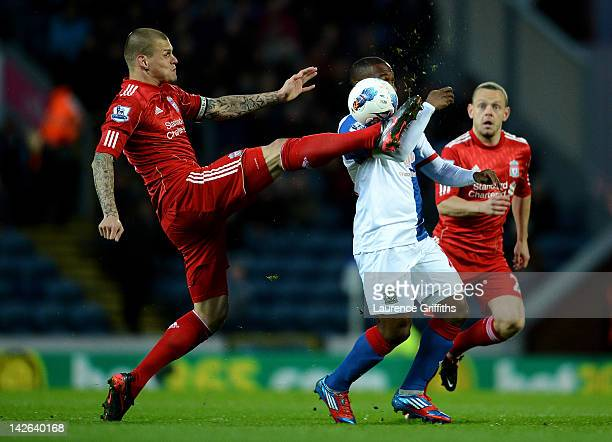 Martin Skrtel of Liverpool competes with Junior Hoilett of Blackburn Rovers during the Barclays Premier League match between Blackburn Rovers and...