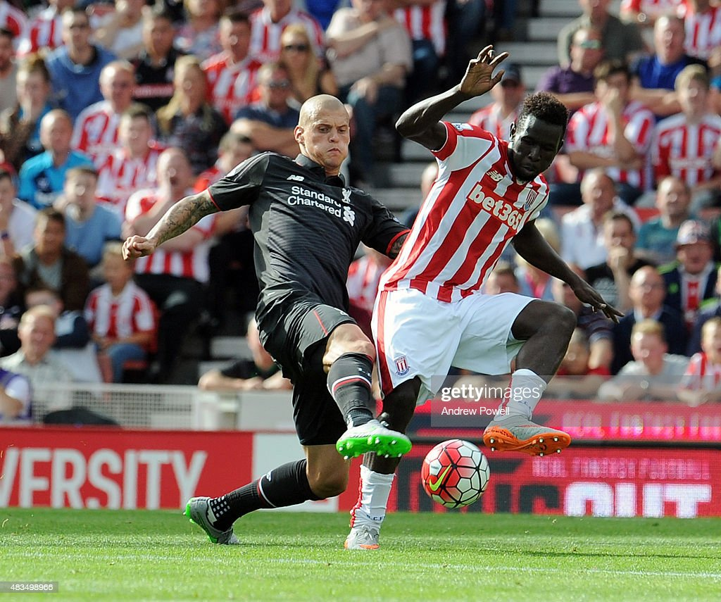 Martin Skrtel of Liverpool competes with Mame Diouf of Stoke City during the Barclays Premier League match between Stoke City and Liverpool at Britannia Stadium on August 9, 2015 in Stoke on Trent, England.