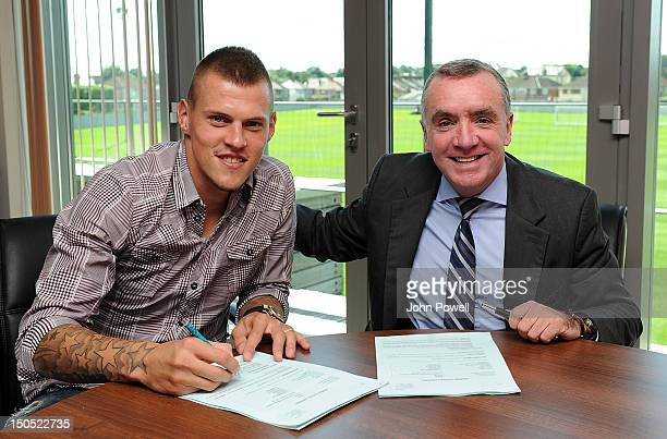 Martin Skrtel of Liverpool extends his contract with Ian Ayre, the Managing Director of Liverpool, at Melwood Training Ground on August 20, 2012 in...