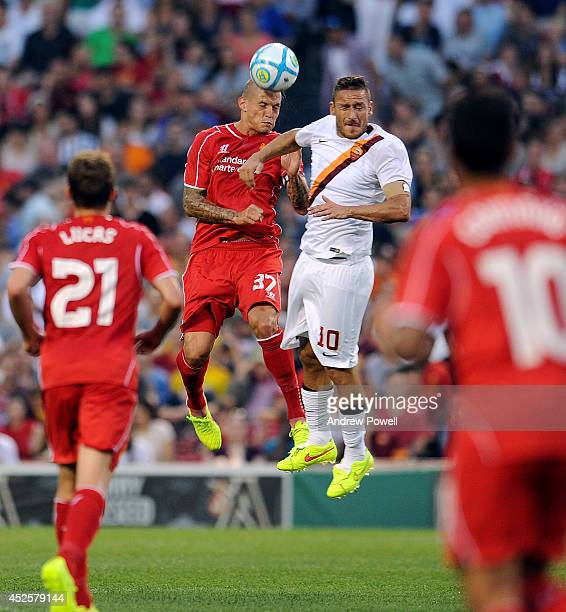 Martin Skrtel of Liverpool goes up with Francesco Totti of AS Roma during the pre season friendly match between Liverpool FC and AS Roma at Fenway...