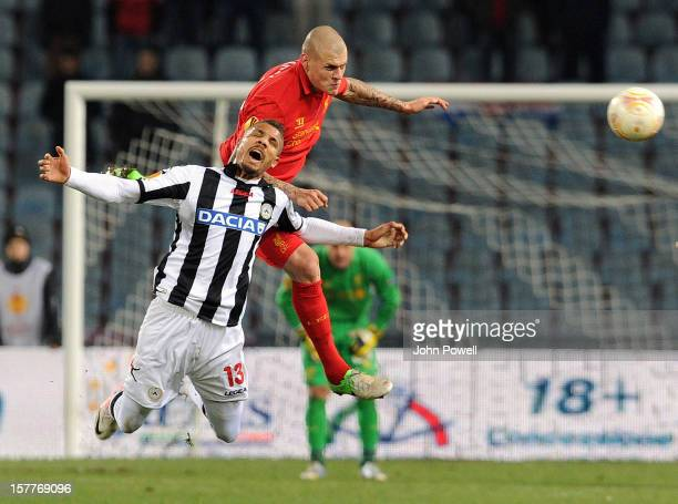 Martin Skrtel of Liverpool goes up with Mathias Ranegle of Udinese Calcio during the UEFA Europa League Group A match between Udinese Calcio and...