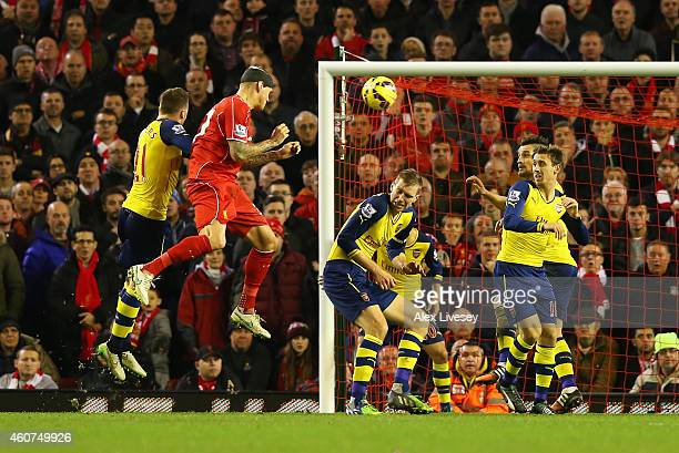 Martin Skrtel of Liverpool heads the equalising goal during the Barclays Premier League match between Liverpool and Arsenal at Anfield on December 21...