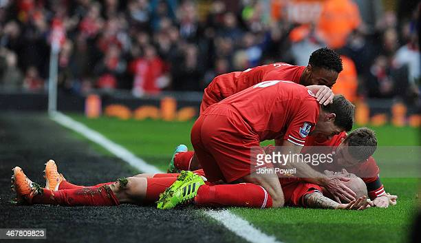 Martin Skrtel of Liverpool is congratulated by his team mates after his second goal during the Barclays Premier League match between Liverpool and...