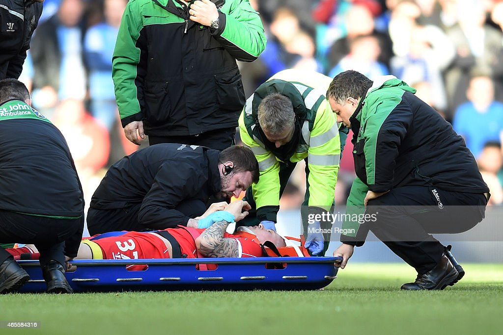 Martin Skrtel of Liverpool leaves the pitch on a stretcher following treatment for a knock to the head during the FA Cup Quarter Final match between Liverpool and Blackburn Rovers at Anfield on March 8, 2015 in Liverpool, England.