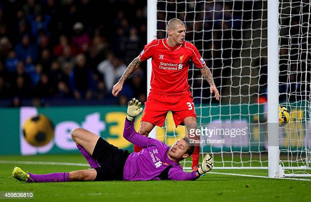 Martin Skrtel of Liverpool looks on as Simon Mignolet of Liverpool scores an own goal during the Barclays Premier League match between Leicester City...