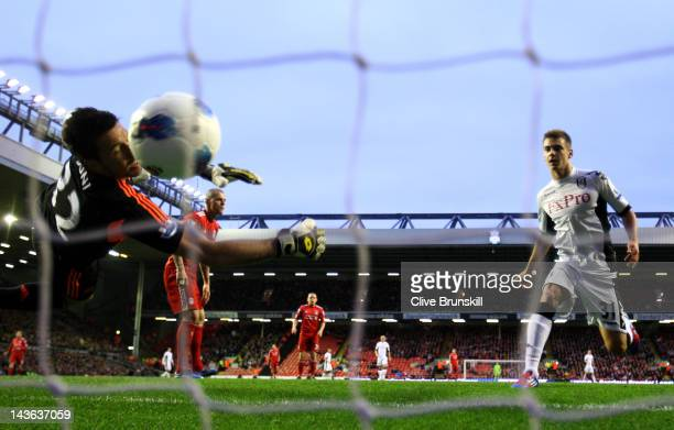 Martin Skrtel of Liverpool scores an own goal past team mate Alexander Doni during the Barclays Premier League match between Liverpool and Fulham at...