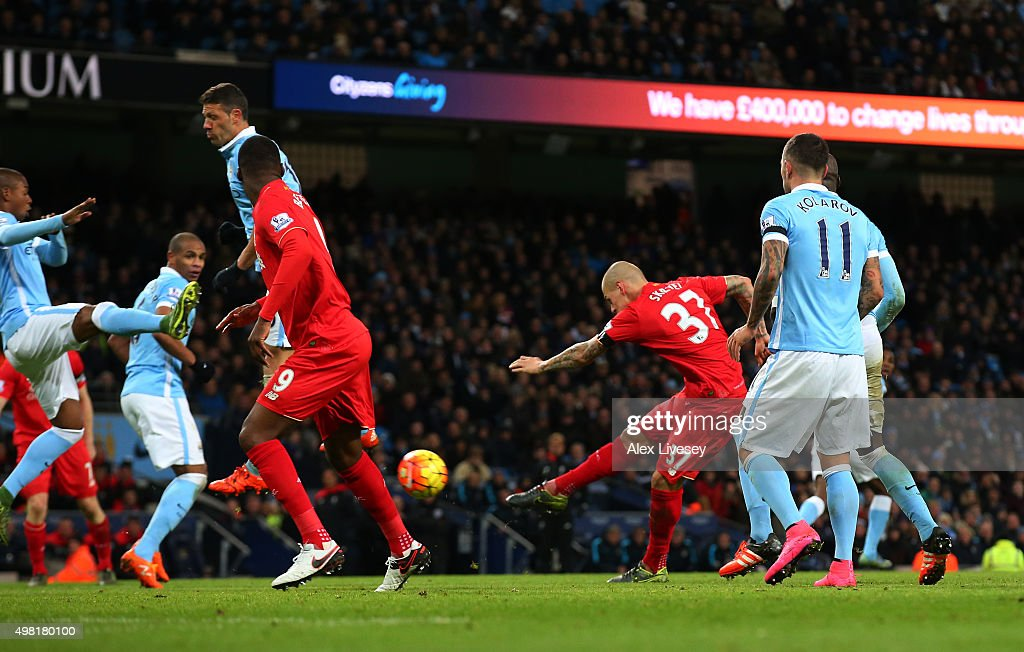 Martin Skrtel of Liverpool scores his team's fourth goal during the Barclays Premier League match between Manchester City and Liverpool at Etihad Stadium on November 21, 2015 in Manchester, England.