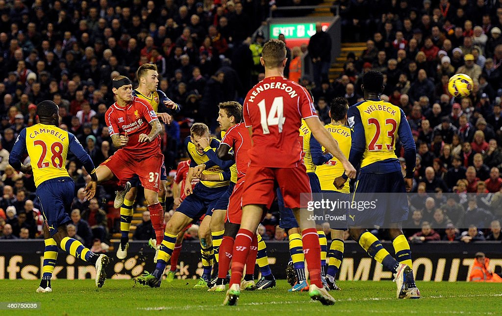 Martin Skrtel of Liverpool scores the equaliser during the Barclays Premier League match between Liverpool and Arsenal at Anfield on December 21, 2014 in Liverpool, England.