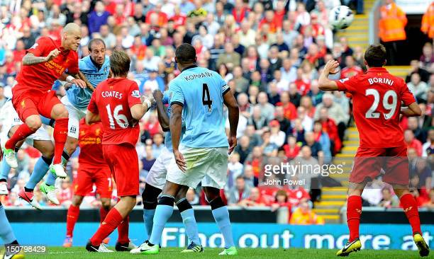 Martin Skrtel of Liverpool scores the first goal during the Barclays Premier League match between Liverpool and Manchester City at Anfield on August...