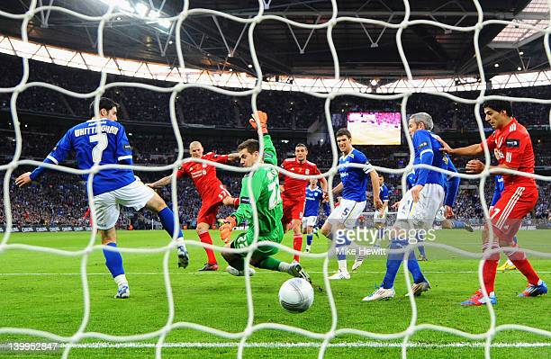 Martin Skrtel of Liverpool shoots past goalkeeper Tom Heaton of Cardiff City to score their first goal during the Carling Cup Final match between...