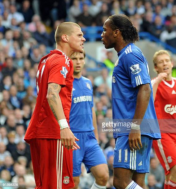 Martin Skrtel of Liverpool shouts at Didier Drogba of Chelsea about a penalty incident during the Barclays Premier League match between Chelsea and...