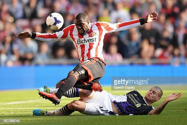 Martin Skrtel of Liverpool tackles Jozy Altidore of Sunderland during the Barclays Premier League match between Sunderland and Liverpool at the...