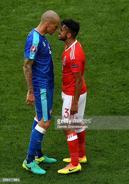 Martin Skrtel of Slovakia and Neil Taylor of Wales face off during the UEFA EURO 2016 Group B match between Wales and Slovakia at Stade Matmut...