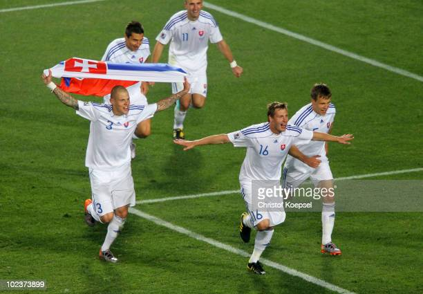 Martin Skrtel of Slovakia celebrates victory with Jan Durica and team mates after knocking Italy out of the competition during the 2010 FIFA World...
