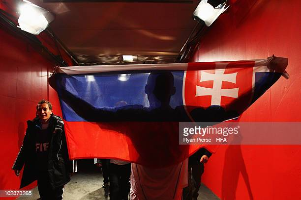 Martin Skrtel of Slovakia celebrates with his national flag in the players tunnel after the 2010 FIFA World Cup South Africa Group F match between...