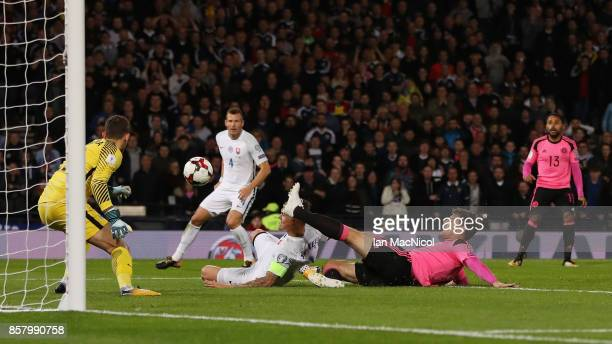 Martin Skrtel of Slovakia scores an own goal for Scotland's first goal during the FIFA 2018 World Cup Group F Qualifier between Scotland and Slovakia...