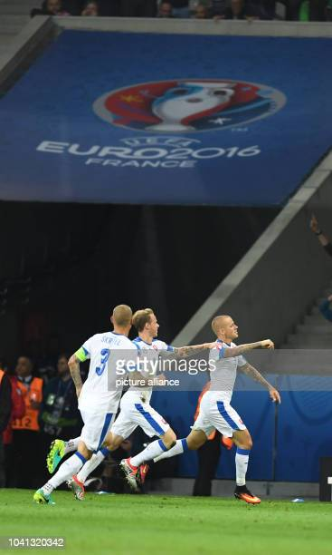 Martin Skrtel Ondrej Duda and goal scorer Vladimir Weiss of Slovakia celabrate after the 01 during the UEFA Euro 2016 Group B soccer match Russia and...