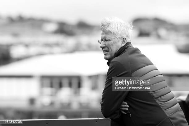 Martin Slumbers, Chief Executive of The R&A, watches players off the first tee during the final round of the 148th Open Championship held on the...