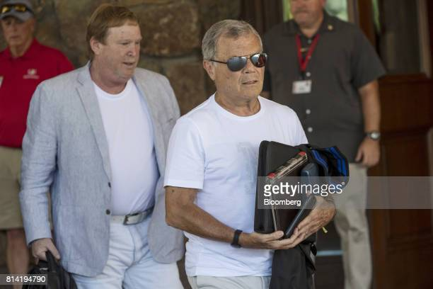 Martin Sorrell chief executive officer of WPP Plc right and Mark Davis owner of the National Football League Oakland Raiders football team leave the...