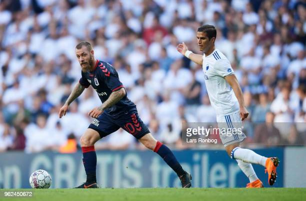Martin Spelmann of AGF Aarhus and Pieros Sotiriou compete for the ball during the Danish Alka Superliga Europa League Playoff match between FC...
