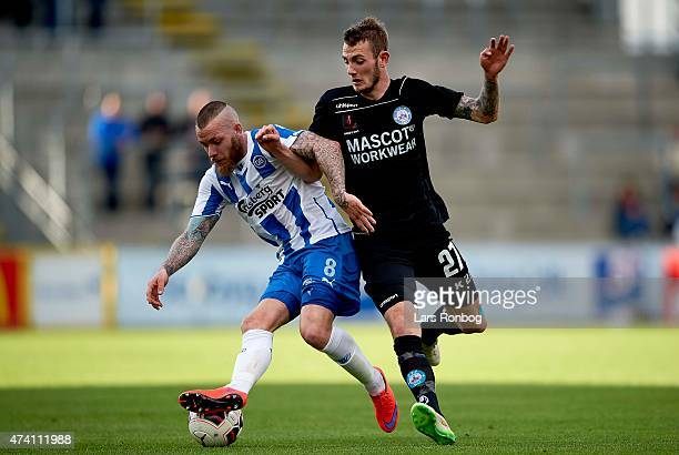 Martin Spelmann of OB Odense and Jens Martin Gammelby of Silkeborg IF compete for the ball during the Danish Alka Superliga match between OB Odense...