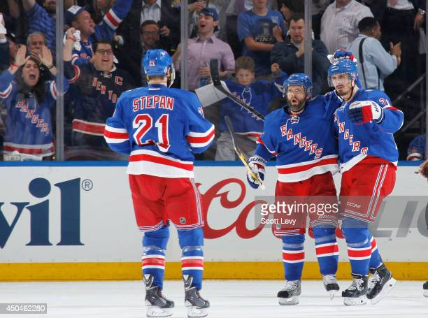 Martin St Louis Chris Kreider and Derek Stepan of the New York Rangers celebrate after a second period goal against the Los Angeles Kings during Game...