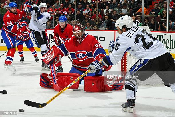Martin St. Louis of Tampa Bay Lightning takes a shot on goalie Carey Price of the Montreal Canadiens during the NHL game on November 07, 2009 at the...