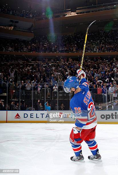 Martin St Louis of the New York Rangers acknowledges the crowd after being named the first star of the game for scoring in the overtime period of...