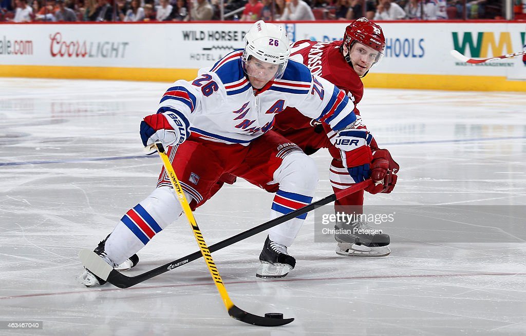 Martin St. Louis #26 of the New York Rangers attempts to skate around Oliver Ekman-Larsson #23 of the Arizona Coyotes during the third period of the NHL game at Gila River Arena on February 14, 2015 in Glendale, Arizona. The Rangers defeated the Coyotes 5-1.