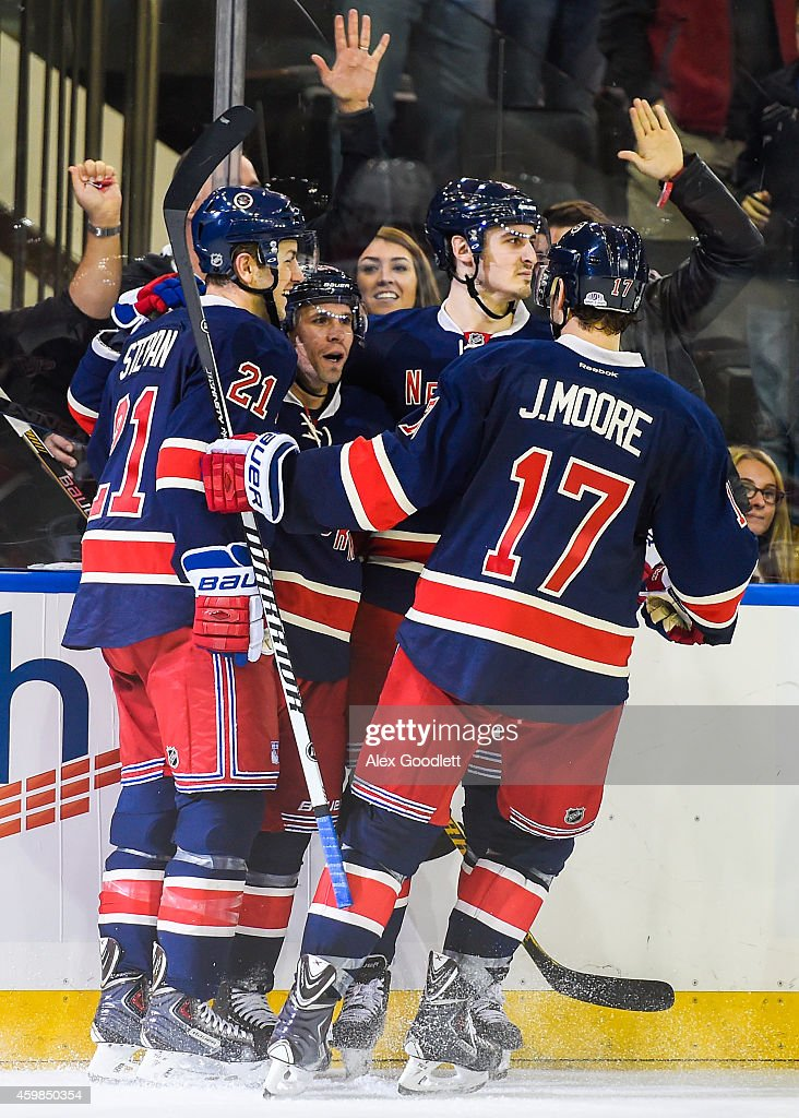 Martin St. Louis #26 of the New York Rangers celebrates a goal with teammates during a game against the Montreal Canadiens at Madison Square Garden on November 23, 2014 in New York City.