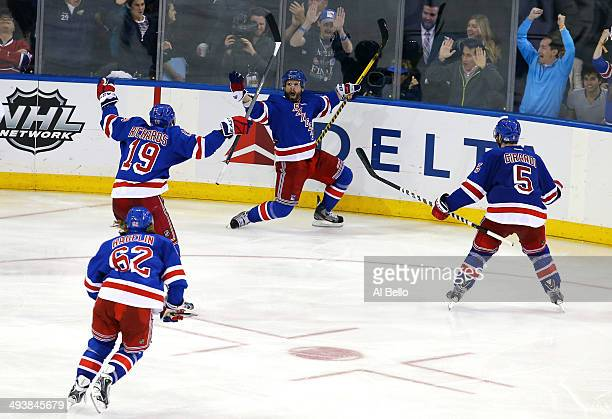 Martin St. Louis of the New York Rangers celebrates after scoring the game winning shot in overtime against Dustin Tokarski of the Montreal Canadiens...