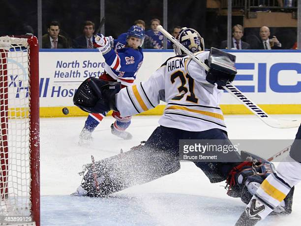 Martin St Louis of the New York Rangers is stopped by Matt Hackett of the Buffalo Sabres during the second period at Madison Square Garden on April...