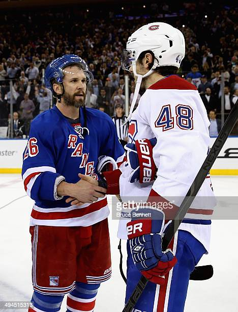 Martin St Louis of the New York Rangers shakes hands Daniel Briere of the Montreal Canadiens after winning Game Six of the Eastern Conference Final...