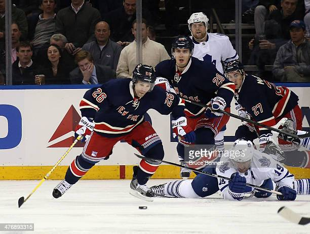 Martin St Louis of the New York Rangers skates Joffrey Lupul of the Toronto Maple Leafs at Madison Square Garden on March 5 2014 in New York City
